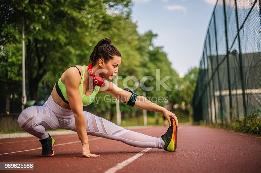520047182istockphoto Girl stretching and exercising woman outdoors 969625586