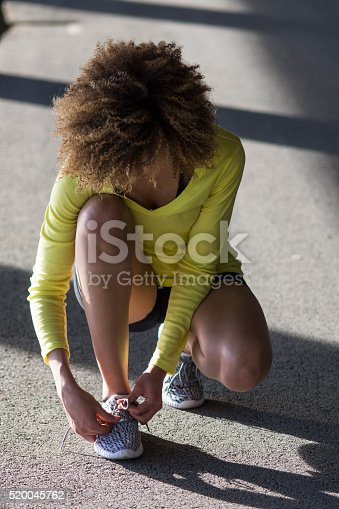 520047182istockphoto Girl stretching and listening to the music on her headphones 520045762