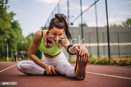 520047182istockphoto Girl stretching and motivated handicapped athlete ready for new challenges 969627820