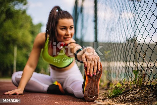 520047182istockphoto Girl stretching and she is happy and satisfied after a hard workout 969625384