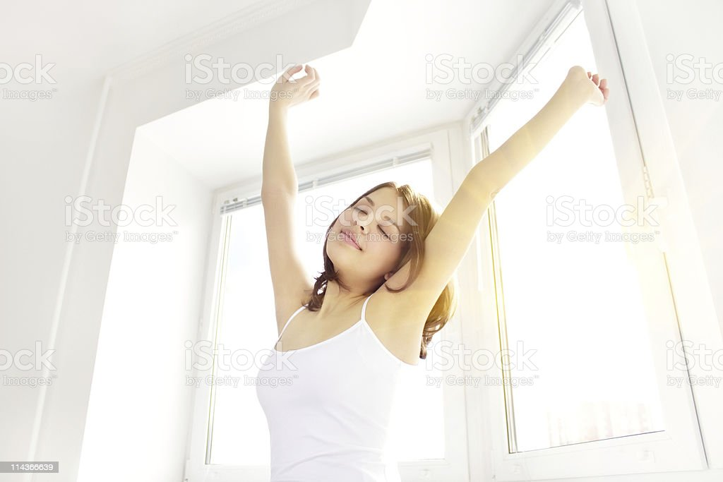Girl stretching in the morning stock photo
