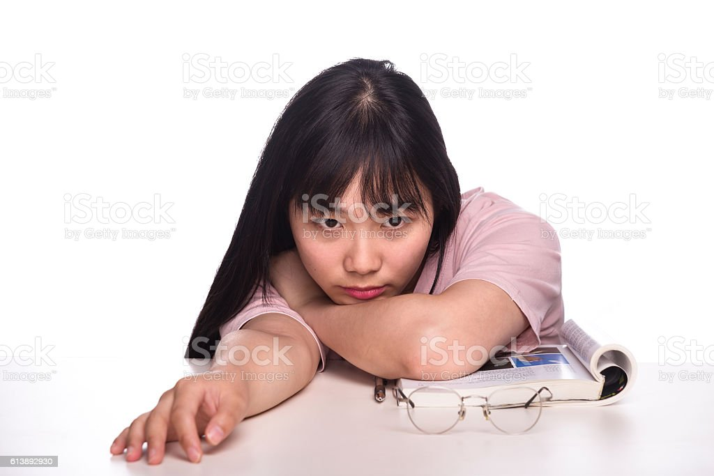 girl student bending over the desk stock photo