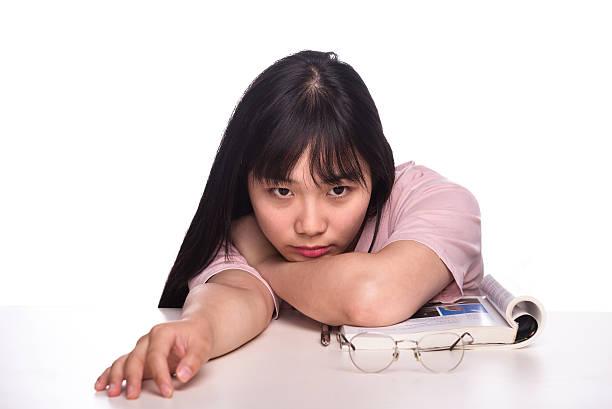 girl student bending over the desk stock photo