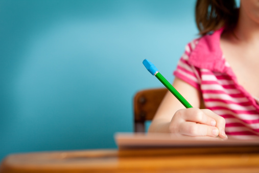 Girl Student Doing Work At School Desk With Copy Space Stock Photo - Download Image Now