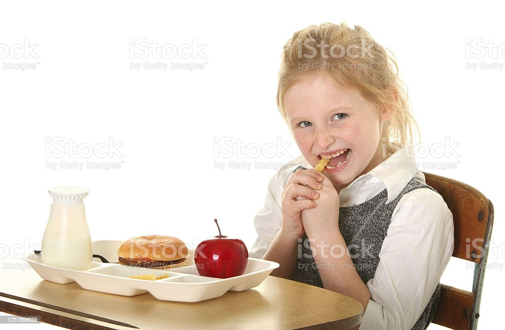girl student eating a french fry royalty-free stock photo