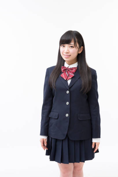 A girl student in uniform A girl student in uniform japanese school girl stock pictures, royalty-free photos & images