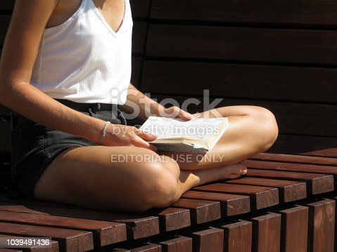 istock Girl student preparing to university reading a book. Correct posture 1039491436