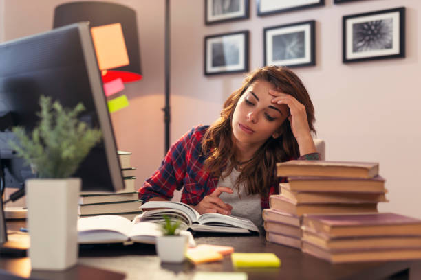 Girl studying for an exam stock photo