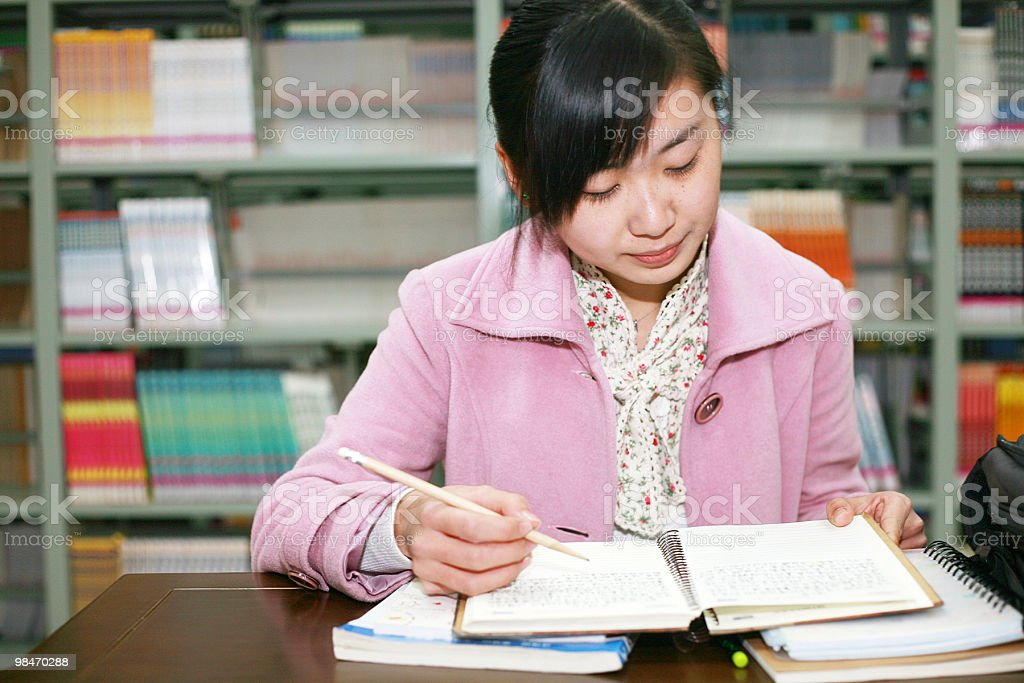 girl studying in library royalty-free stock photo