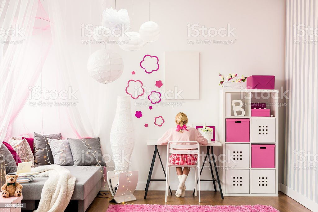Girl studying in room stock photo
