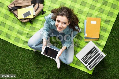 istock Girl studying outdoors 910367070