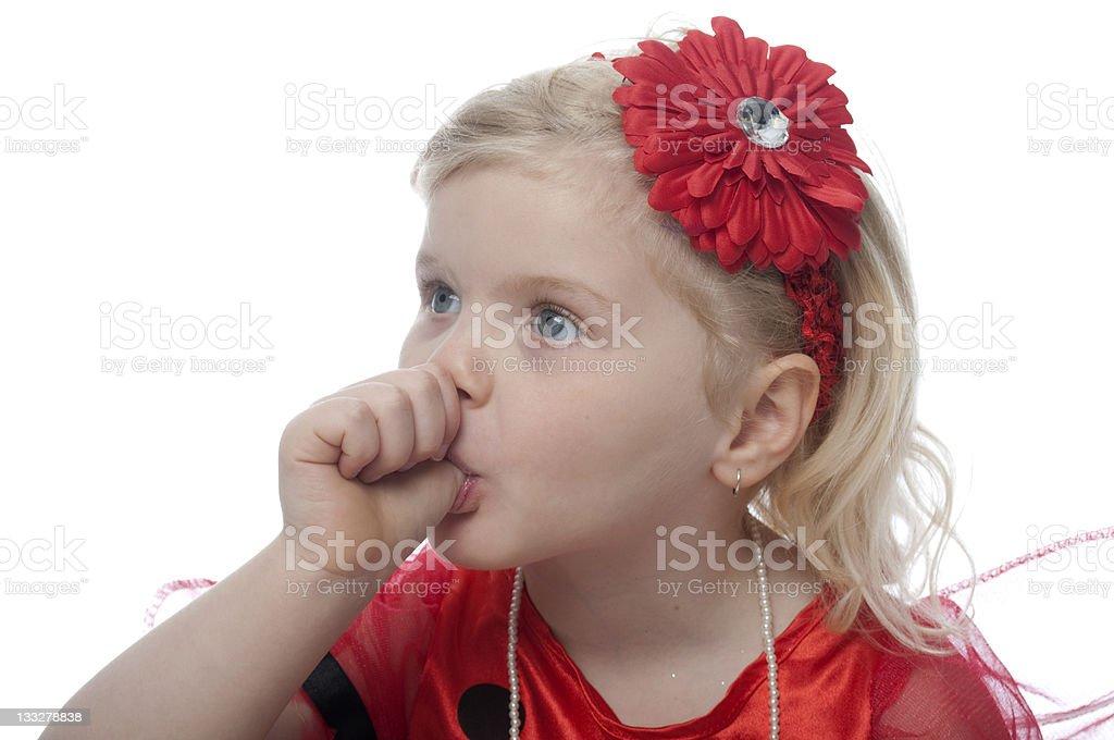 girl sucking thumb stock photo