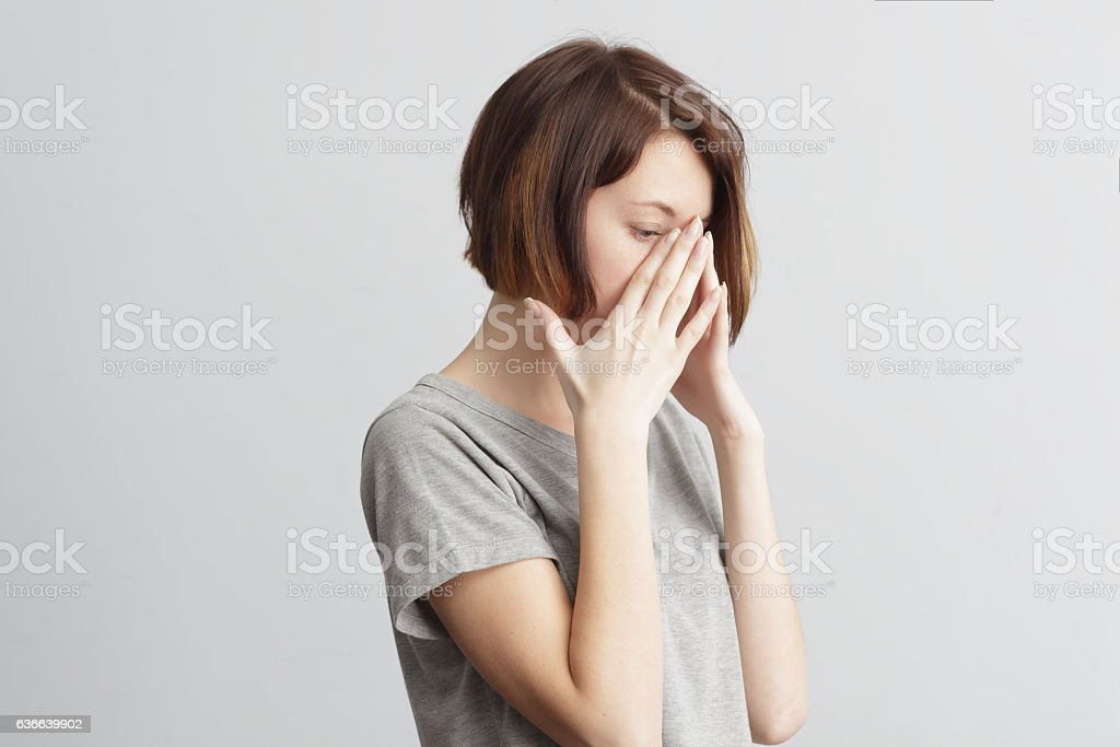 girl suffers from terrible headaches and compresses the head wit stock photo