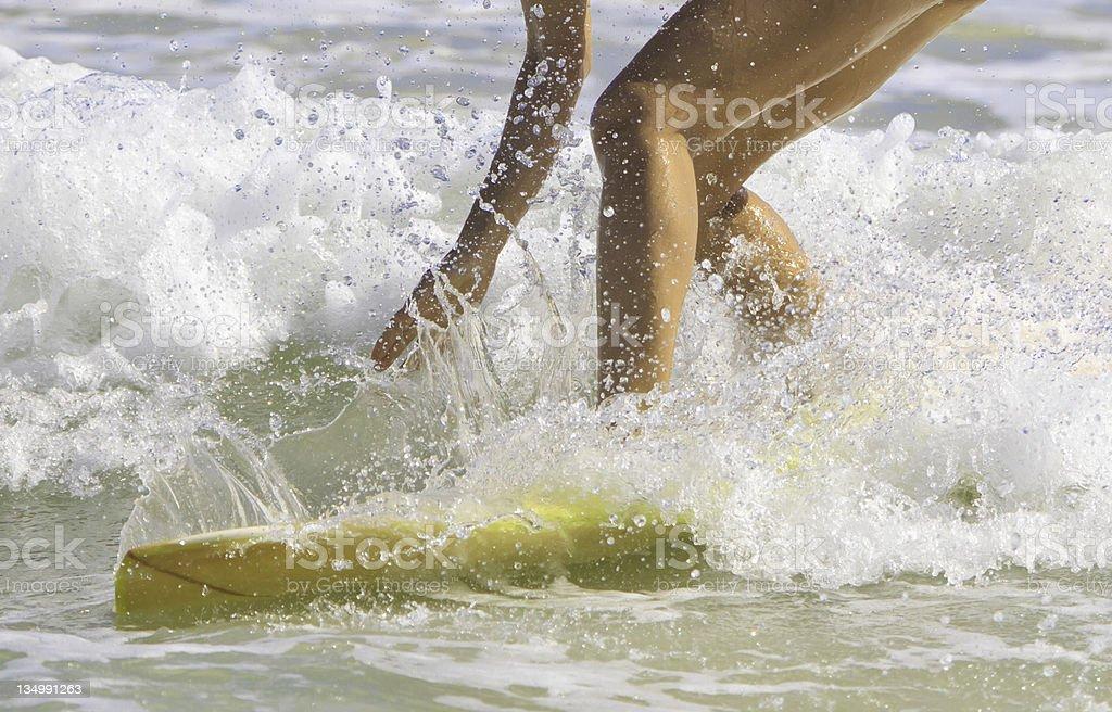 girl surfing at Kailua Beach, Hawaii stock photo