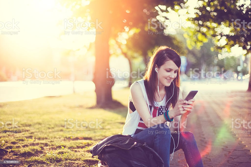 Girl surfing the net on smartphone stock photo