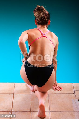 177281231 istock photo Girl swimmer preparing to  jumping and diving 479650314