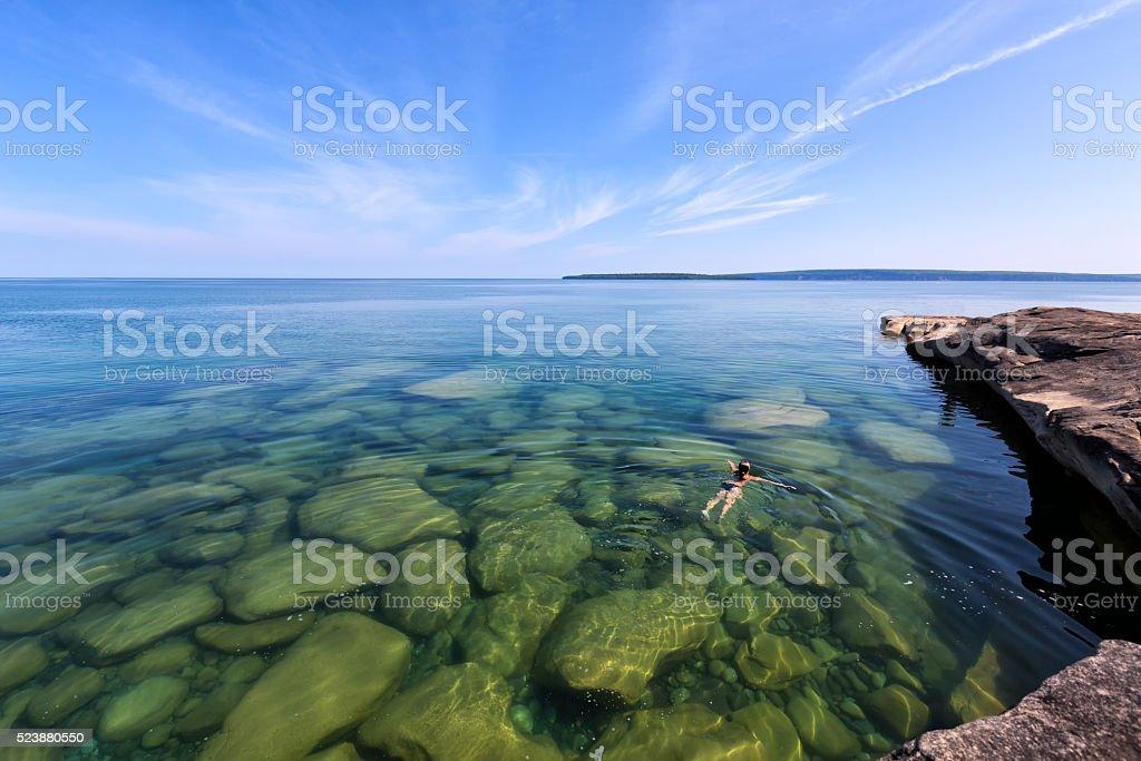 Girl Swimming in Lake Superior - Upper Peninsula - Michigan stock photo