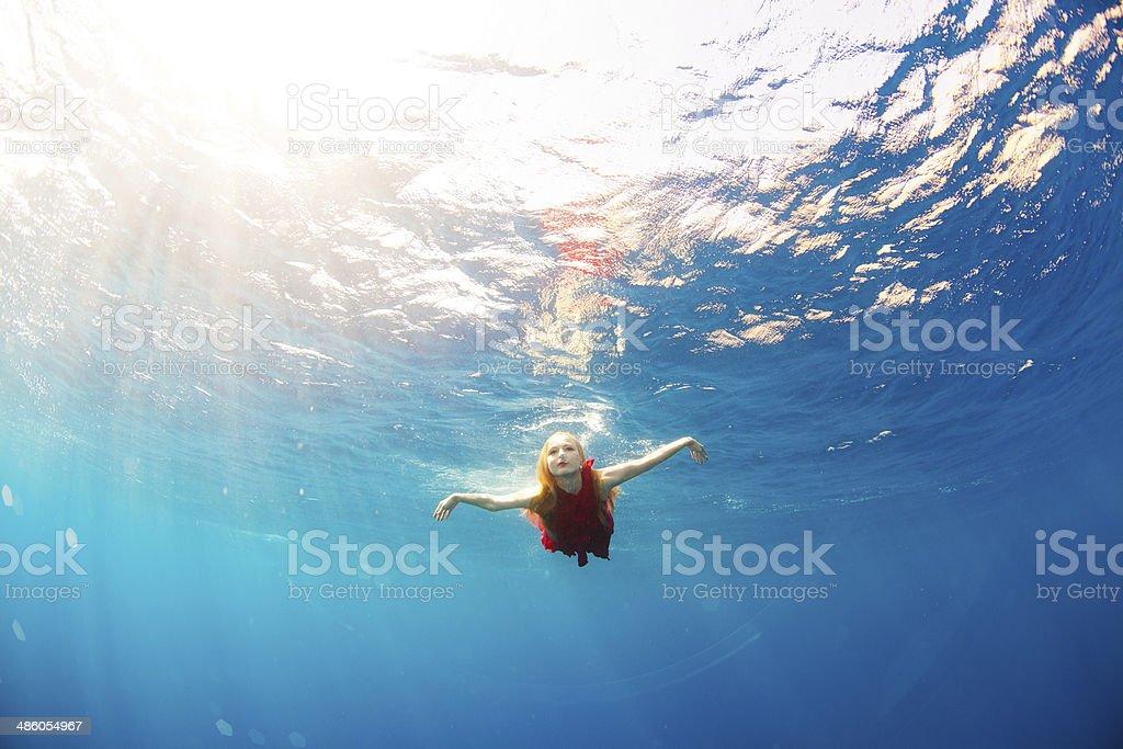 girl swimming underwater royalty-free stock photo