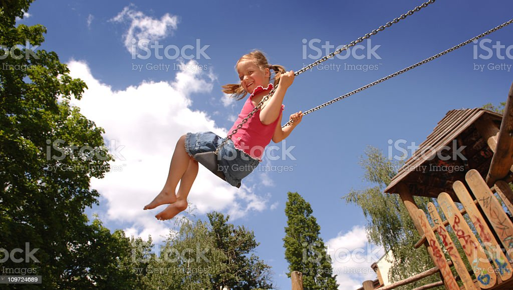 girl swinging royalty-free stock photo