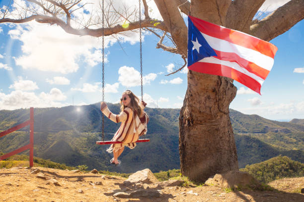 Girl Swinging Puerto Rico stock photo