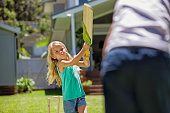 istock girl swings at bat in game of cricket 498378146