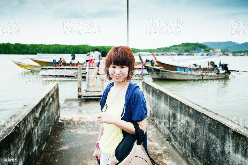 Girl take life jacket ready to get long Thai boat royalty-free stock photo