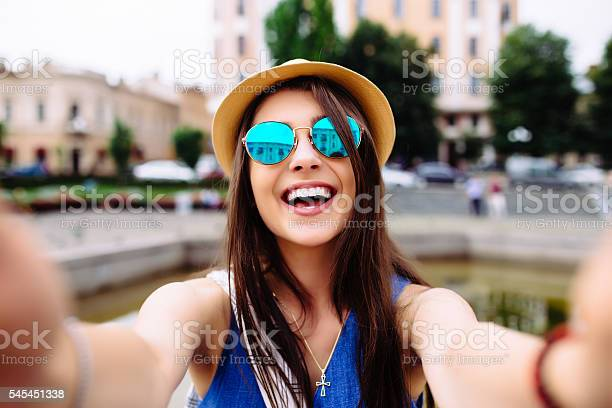 Girl take selfie from hands with phone on summer street picture id545451338?b=1&k=6&m=545451338&s=612x612&h=c0 ohsnihrpmcaqrlxan4 asp 3yuquz1wwe7b3gl7a=
