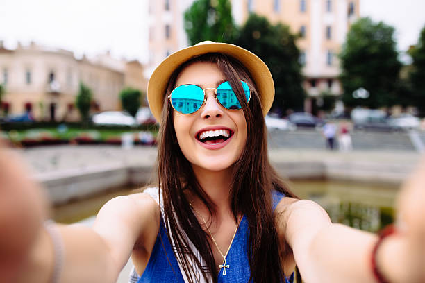 girl take selfie from hands with phone on summer  street. stock photo