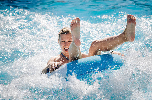 Girl takes a ride at a water park stock photo