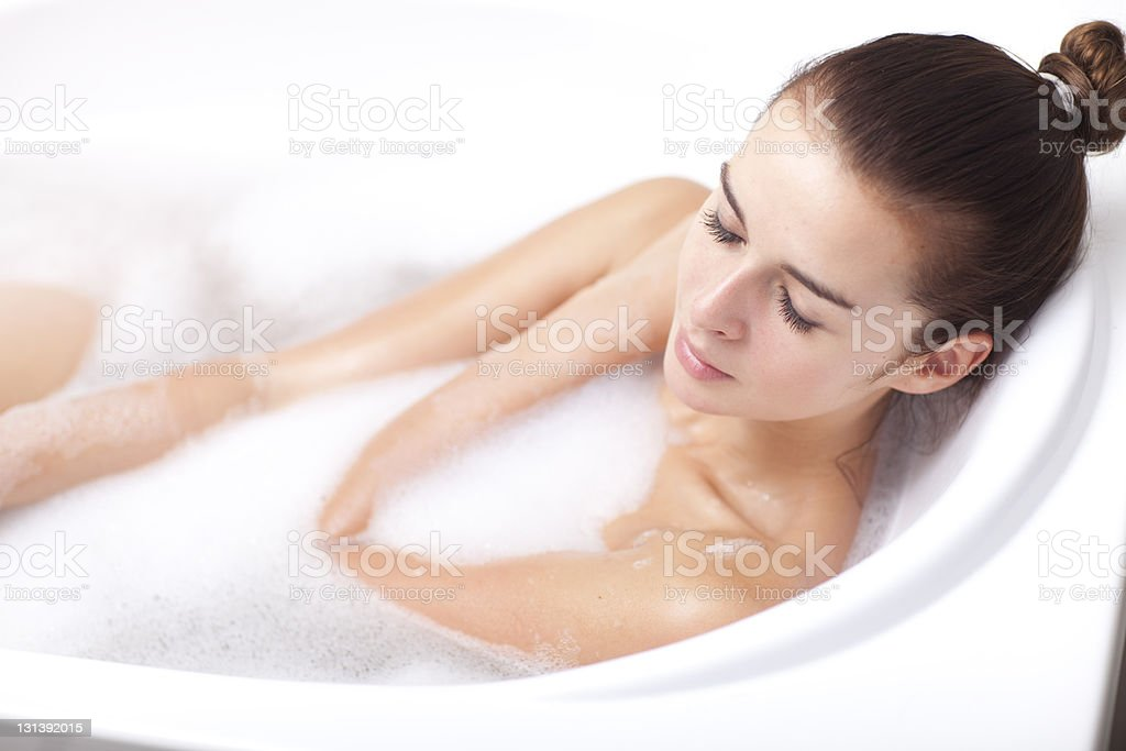 Girl taking a bath. royalty-free stock photo
