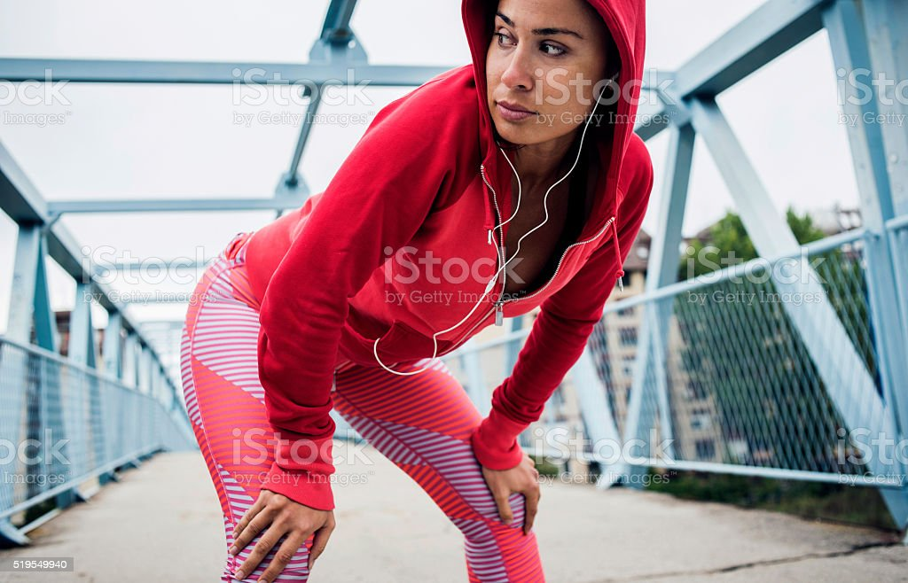 Girl taking a break after workout stock photo