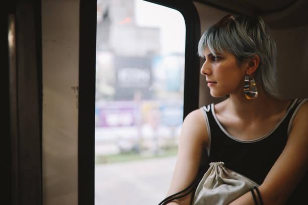 girl taking a bus ride - showus стоковые фото и изображения