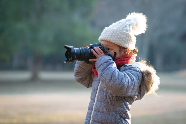 Girl taking a picture Girl taking a picture child prodigy stock pictures, royalty-free photos & images