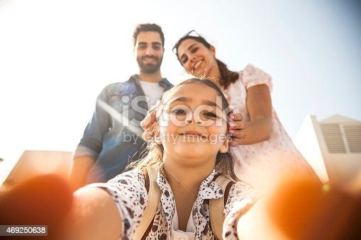 istock Girl taking a selfie with parents 469250638