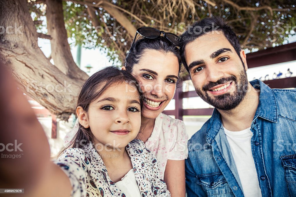Girl taking a selfie with parents royalty-free stock photo