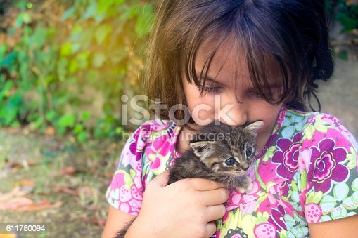 istock Girl taking care of the baby cat 611780094