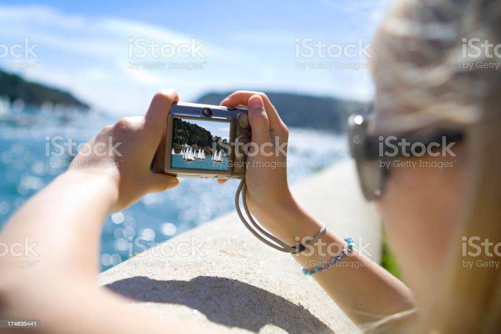 Girl Taking Photo of Yachts royalty-free stock photo