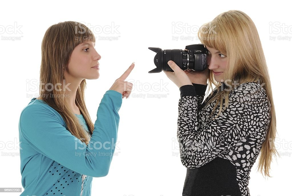 Girl taking picture of friend royalty-free stock photo