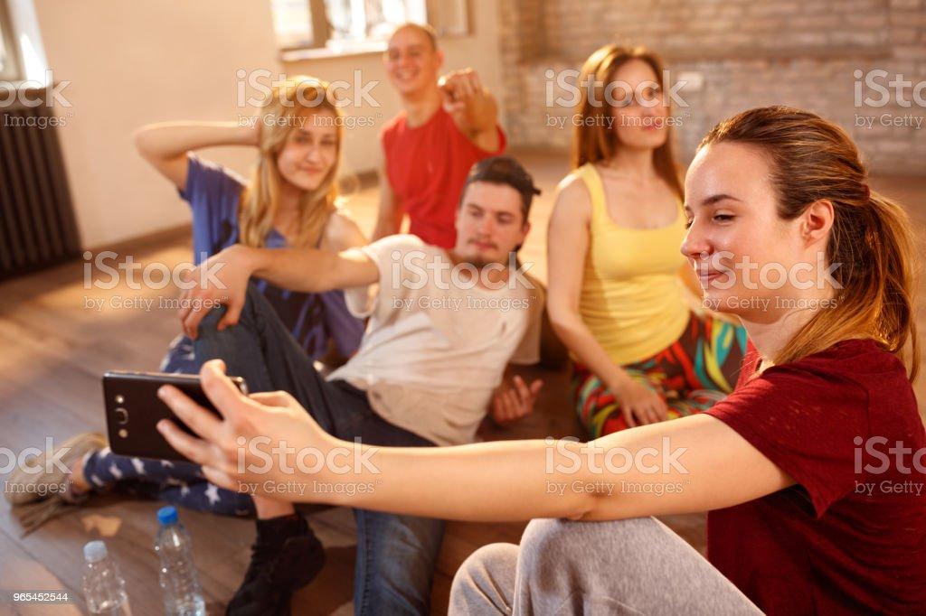 Girl taking selfie with friends in fitness studio zbiór zdjęć royalty-free
