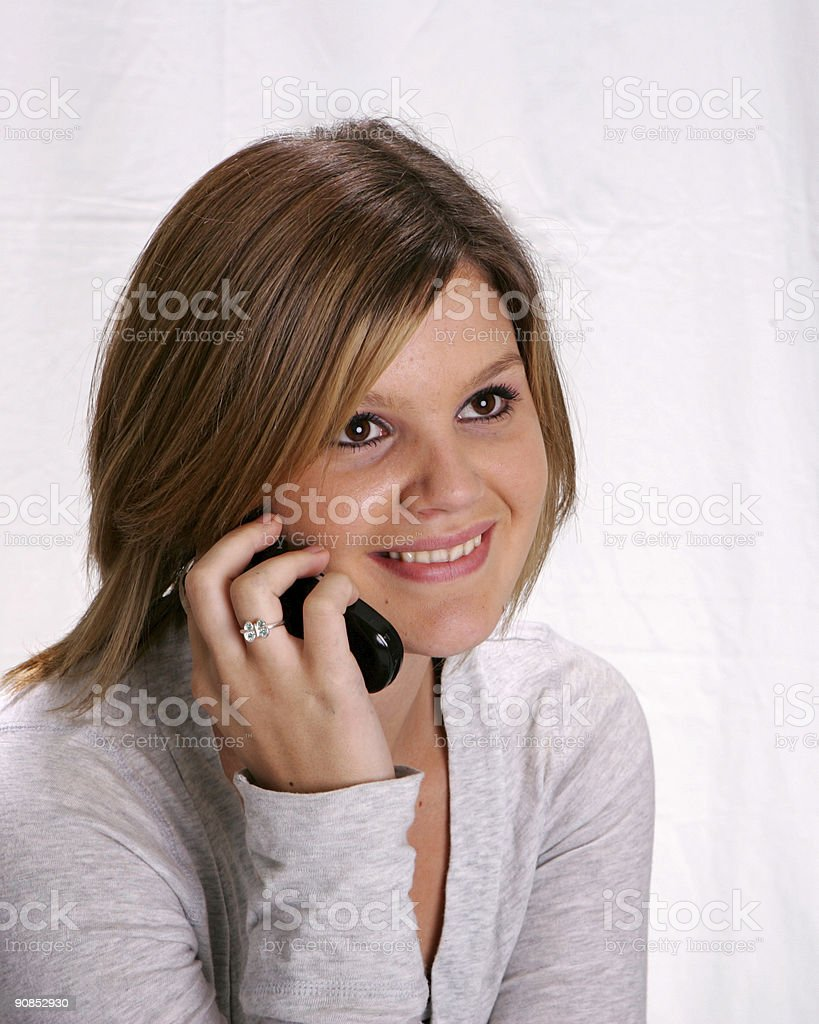 Girl talking on a cell phone stock photo