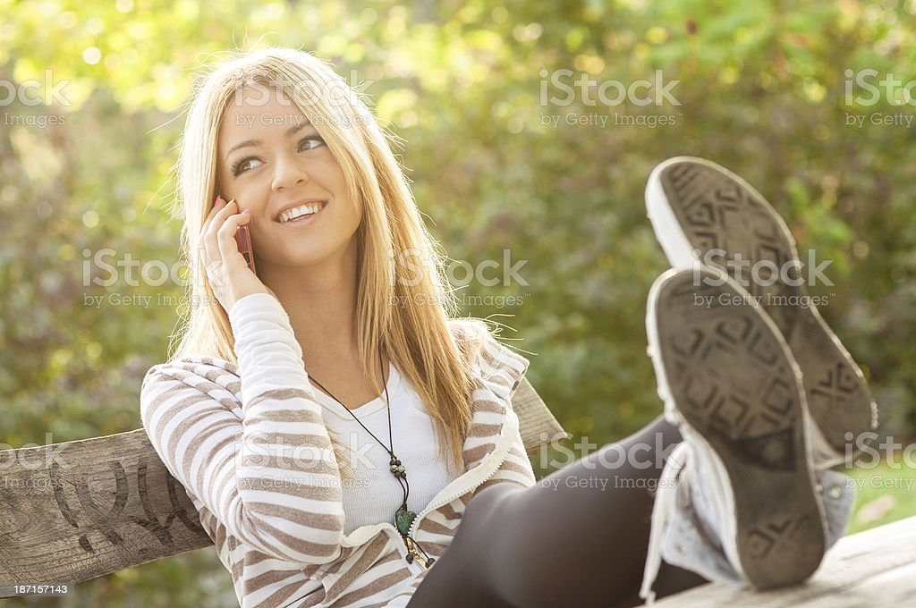 Girl talking on mobile phone royalty-free stock photo