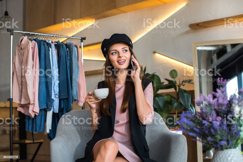 girl talking on smartphone in boutique royalty-free stock photo