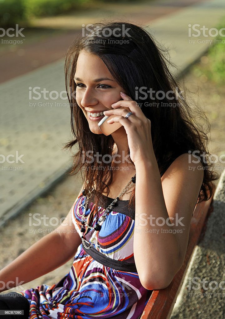 Girl talks on mobile phone royalty-free stock photo