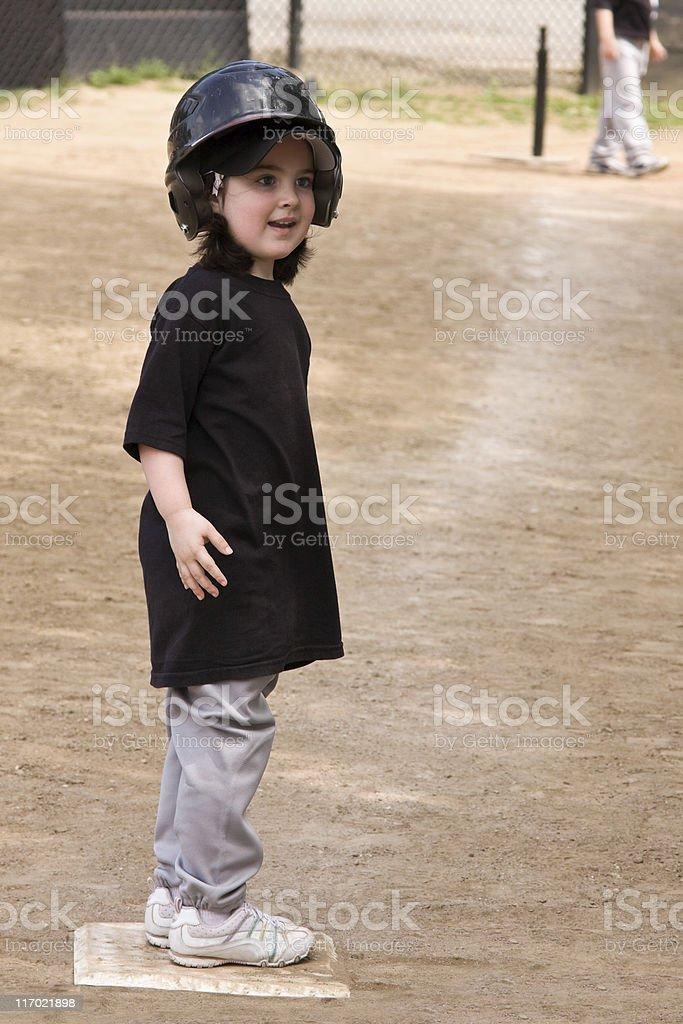 Girl t-ball player stock photo