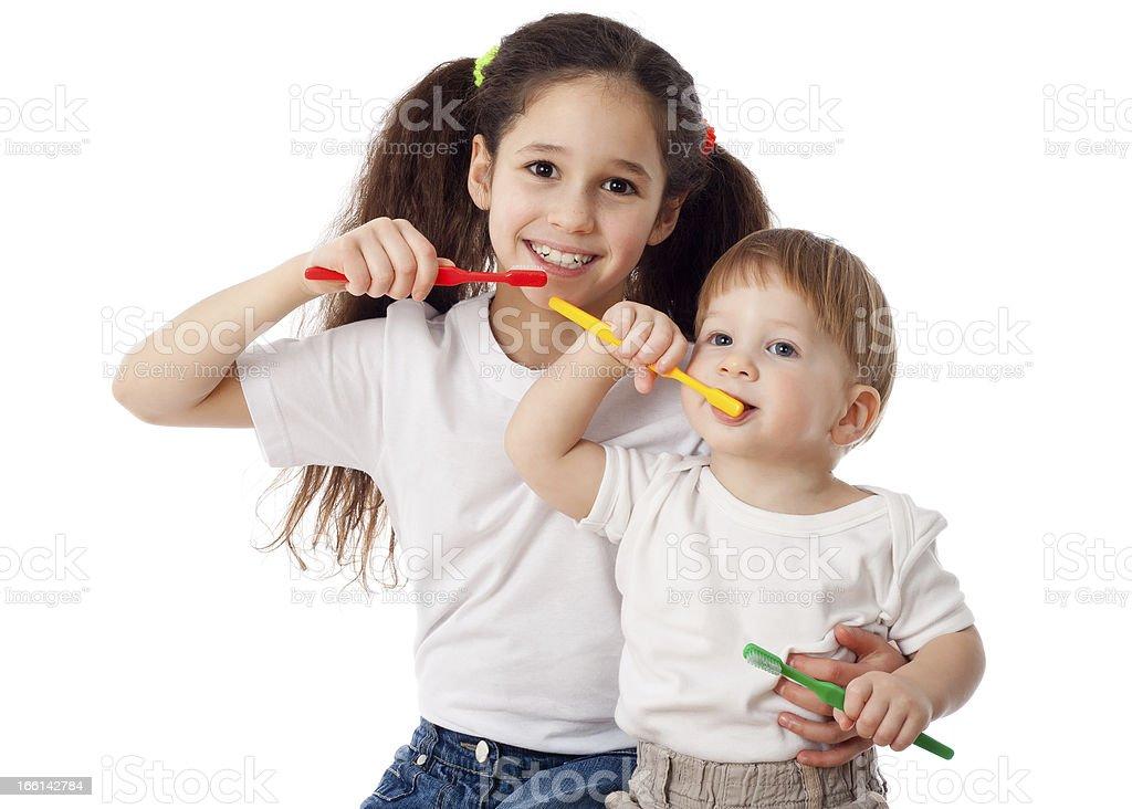 Girl teaches boy brushing teeth royalty-free stock photo