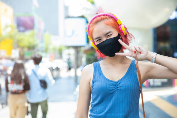 girl teen cute punk hipster style red hair color wear face mask or face shield at outdoor public shopping walking street. - covid hair imagens e fotografias de stock