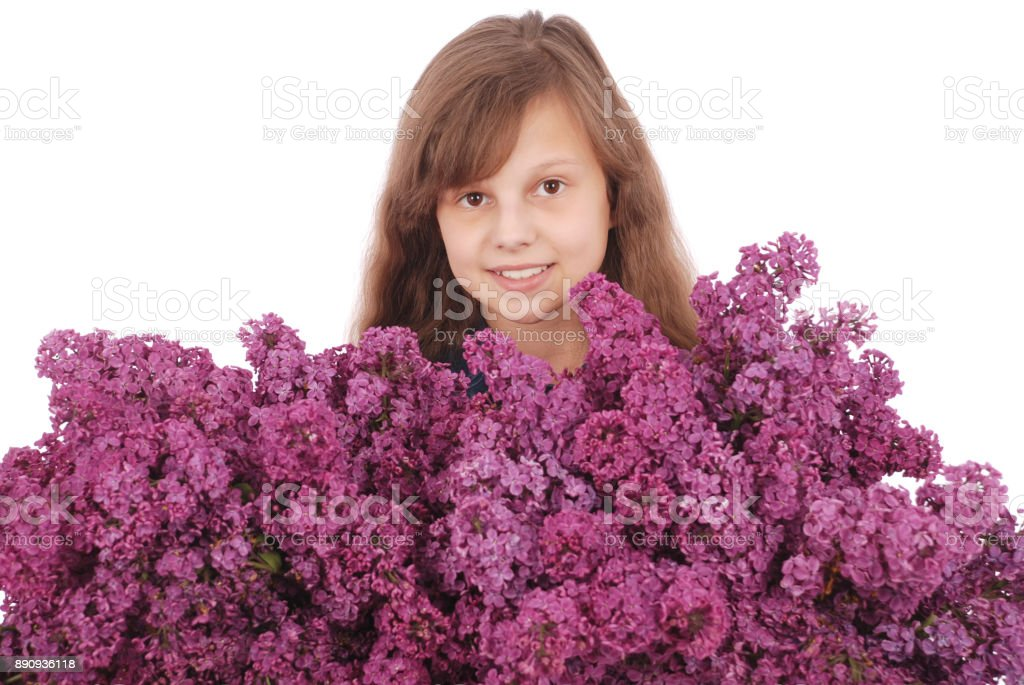 Girl teenager standing with lilac in hands stock photo