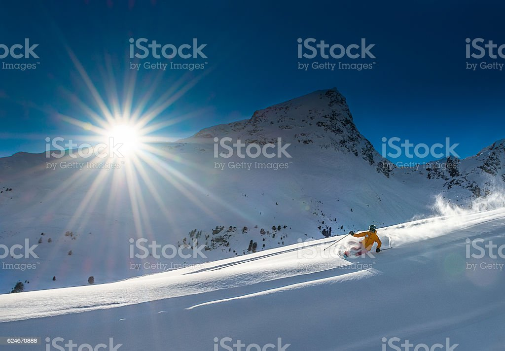 Girl telemark skiing snow slope in mountains stock photo