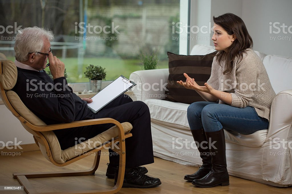 Girl telling about her problems Girl telling about her problems on therapy 2015 Stock Photo