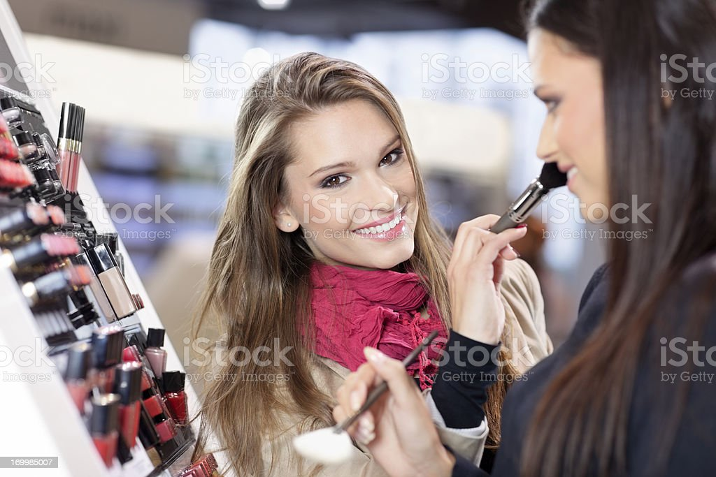 Girl testing and  purchases cosmetics in the beauty shop royalty-free stock photo